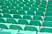 Rows plastic seats on arena — Stock Photo