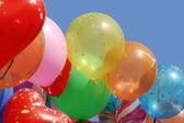 Balloons against blue sky — Stock Photo