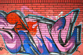 Graffiti on brick wall — Stock Photo