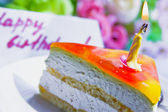 Cake with candle for birthday — Stock fotografie