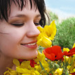 Woman smelling flowers — Foto Stock