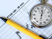 Analyzing graph, stopwatch and pen — Stock Photo