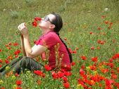 Women in poppy field — Stock Photo