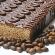 Chocolaty  cake and coffee beans close up — Stock Photo