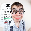 Person wearing spectacles in office at doctor — Stock Photo #5538294