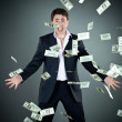 Man in a suit throws money — Stock Photo #5538296