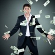 Man in a suit throws money — Stock Photo