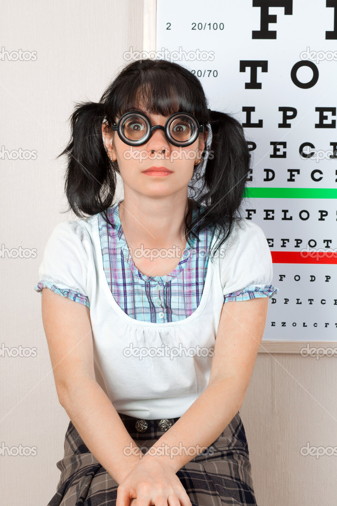 Person wearing spectacles in an office at the doctor — Stock Photo #5538290