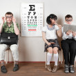 Three person wearing spectacles in an office at the doctor - Stock Photo