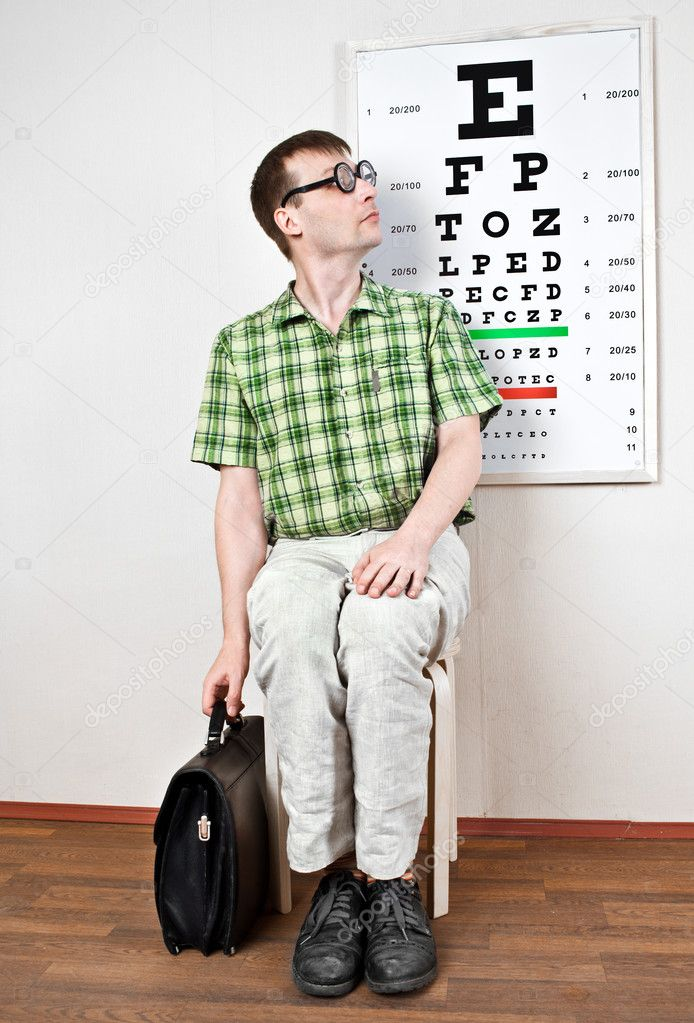 Person wearing spectacles in an office at the doctor — Stock Photo #5582995