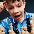 Wunderkind play chess — Stock Photo #5792139