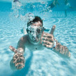 Man floats in pool — Stock Photo