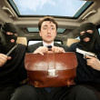 Businessman grasped in hostages. — Stock Photo #6253769