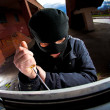 Robber in a mask - Stock Photo