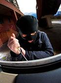 грабитель в маске — Стоковое фото