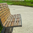 Wooden bench in a city park — Stock Photo