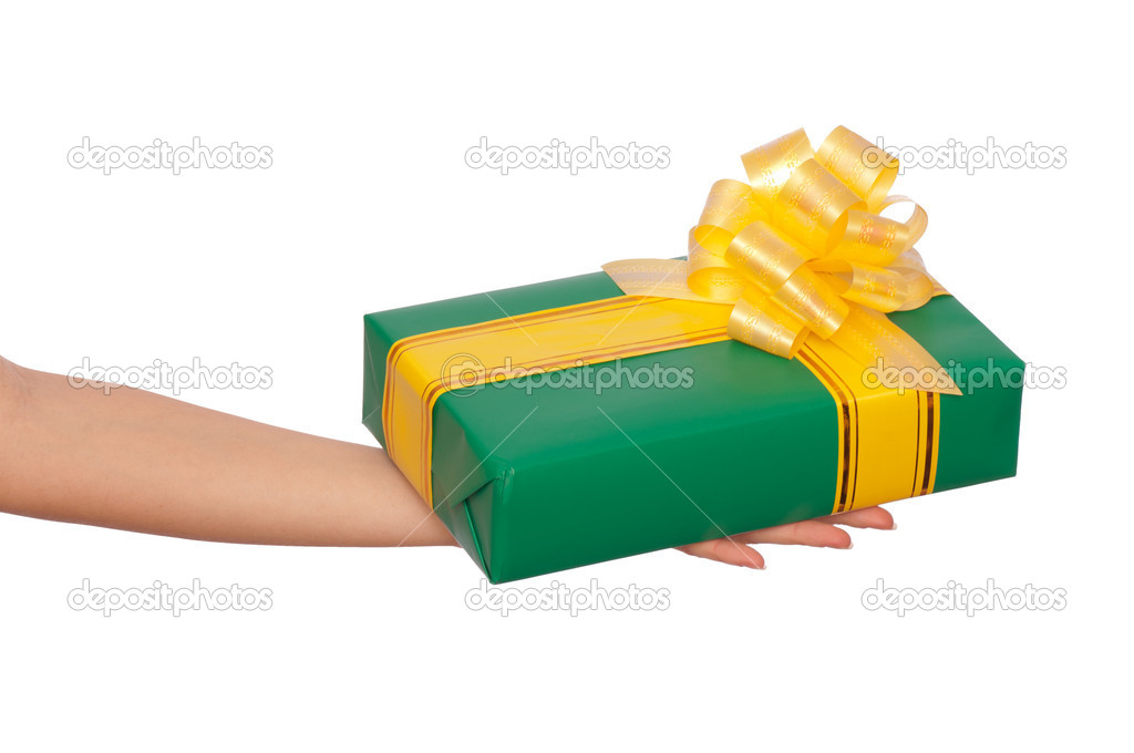 Woman giving a green box with yellow ribbon as a gift — Stock Photo #5410627