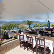 Постер, плакат: Restaurant and beautiful sea view