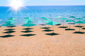 Beach and parasols in resort Turkey. — Stock Photo