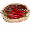 Splendid, wooden basket full of red peppers — Stock Photo #6281935
