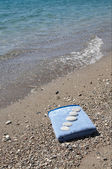 Several pebbles on the nice towel. — Stock Photo
