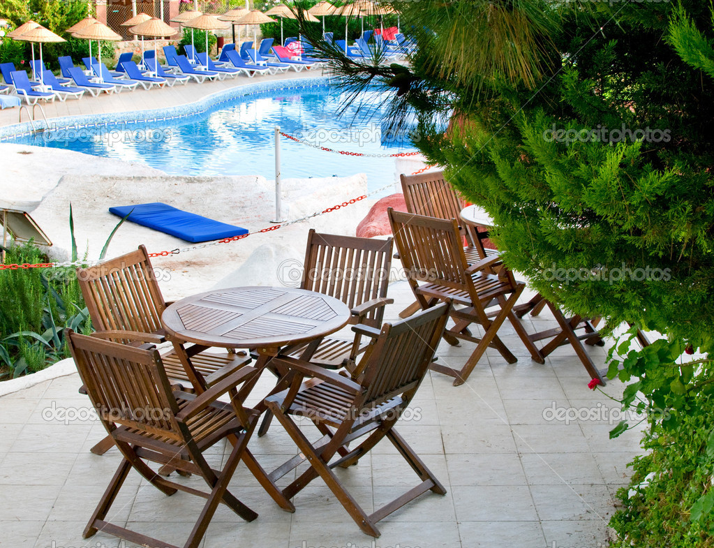 Hotel Patio With Tables And Chairs Next To Swimming Pool Stock Photo Lypnyk2 6283564