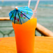 Tasty cocktail with paper umbrella against Red Sea. — Stock Photo