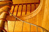 Wonderful wooden ceiling and spiral staircase in the modern hous — Stock Photo