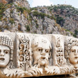 Ancient,abandoned masks and tombs in Myra.Turkey. - Foto Stock