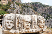 Ancient,abandoned masks and tombs in Myra.Turkey. — Stock Photo