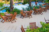 Chairs, tables and swimming pool early morning. — Stock Photo