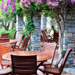 Wooden chairs and table in resort Ora. Turkey. — Foto de stock #6387422