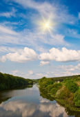 Small river and sun in the blue sky. — Stock Photo