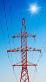 Blue sky and electrical pylon. — Stock Photo