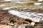 Sea-wave and stones at the coastline. — Stock Photo