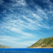 Blue sky with clouds and wonderful sea. — Stock Photo