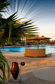 A hotel pool early morning in egyptian resort.. — Stock Photo