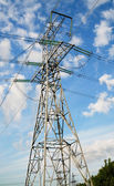 Wonderful blue sky and electrical pylon. — Stock Photo
