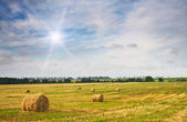 Haystack and stubble by summertime. — Stock Photo