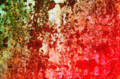 Oxidized metal sheet covered with old paint. — Stock Photo