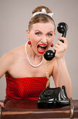 Woman shouting into telephone — Stock Photo