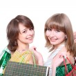 Two happy friends with purchases — Stock Photo #5582024