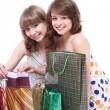 Two happy friends with purchases — Stock Photo