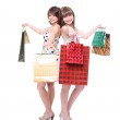 Two happy friends with purchases. — Stock Photo #5583480