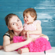 Mum embraces the small daughter. — Stock Photo