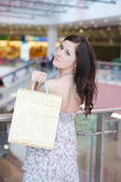Girl with purchases — Stockfoto