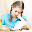 Tired ten years' schoolgirl learns lessons — Stock Photo