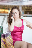 Girl in a pink dress with a mobile phone — Stock Photo