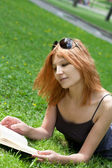 Cute young girl with laptop outdoors — Stock Photo