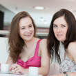Two girls sitting in cafe — Stock Photo #6060897